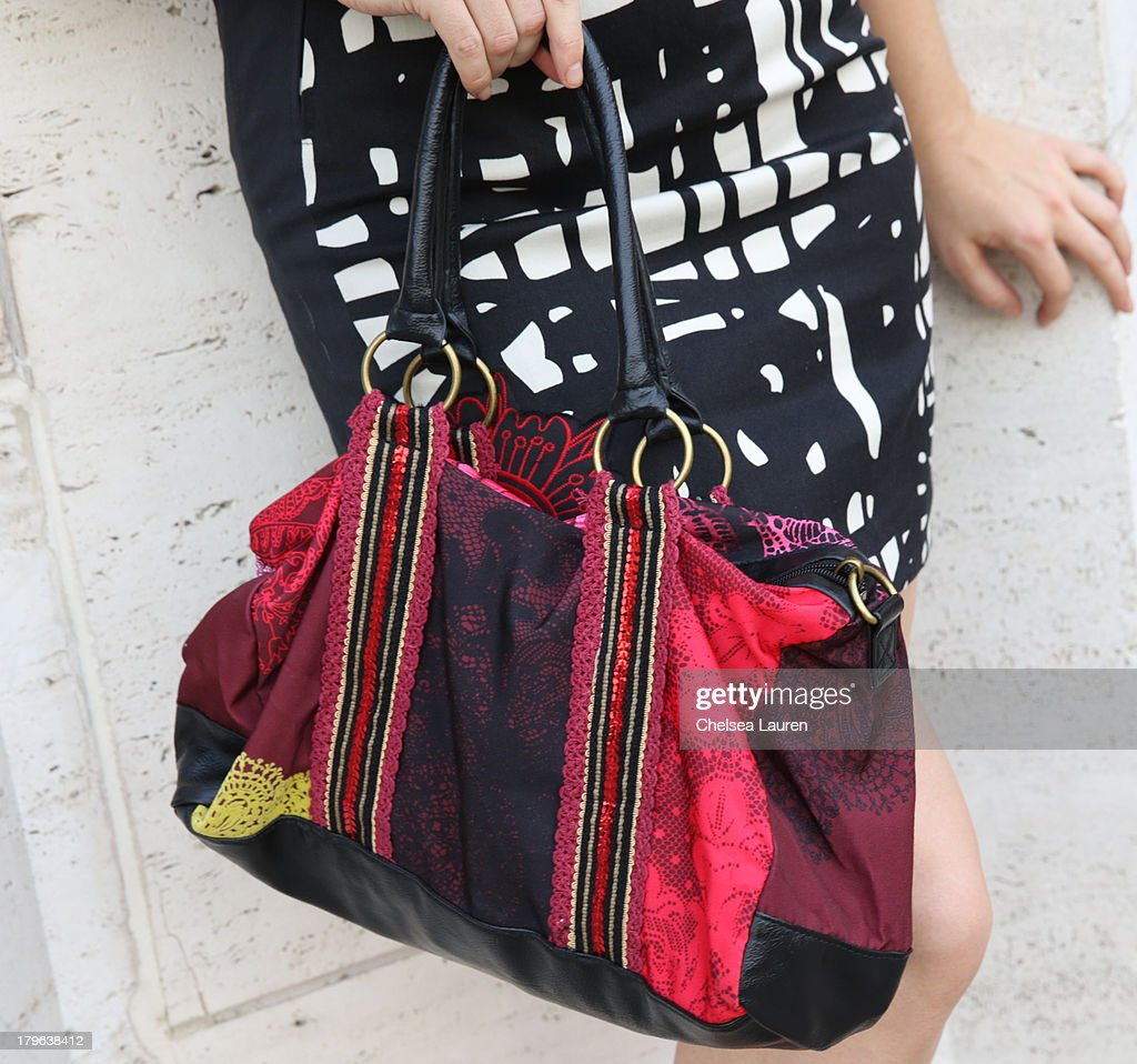 Recording artist Olivia Cipolla (purse detail) is seen wearing Desigual on the Streets of Manhattan on September 5, 2013 in New York City.