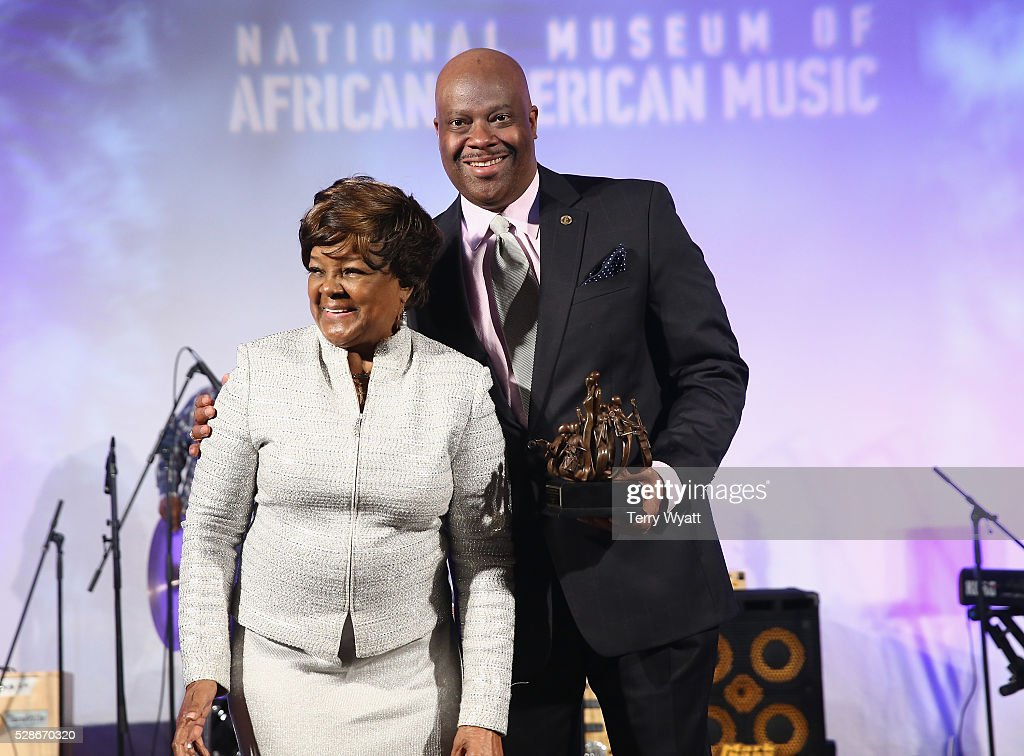 Recording artist Pastor <a gi-track='captionPersonalityLinkClicked' href=/galleries/search?phrase=Shirley+Caesar&family=editorial&specificpeople=828879 ng-click='$event.stopPropagation()'>Shirley Caesar</a> (L) receives honor from President & CEO at National Museum of African American Music H. Beecher Hicks III (R) onstage during NMAAM's Celebration Of Legends Red Carpet And Luncheon on May 6, 2016 in Nashville, Tennessee.