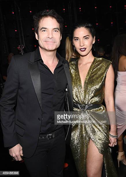 Recording artist Patrick Monahan and actress Olivia Munn attends the 2014 American Music Awards at Nokia Theatre LA Live on November 23 2014 in Los...