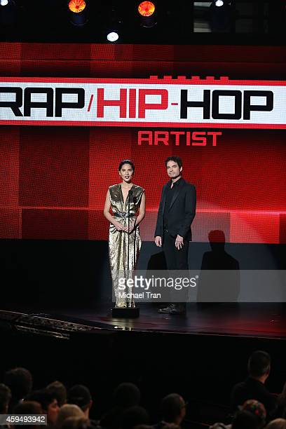 Recording artist Patrick Monahan and actress Olivia Munn onstage during the 2014 American Music Awards held at Nokia Theatre LA Live on November 23...