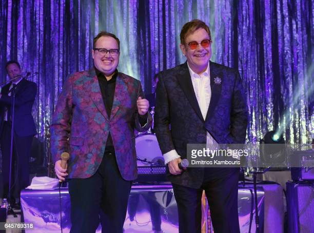 Recording artist Paul Janeway and Sir Elton John perform onstage at the 25th Annual Elton John AIDS Foundation's Academy Awards Viewing Party at The...