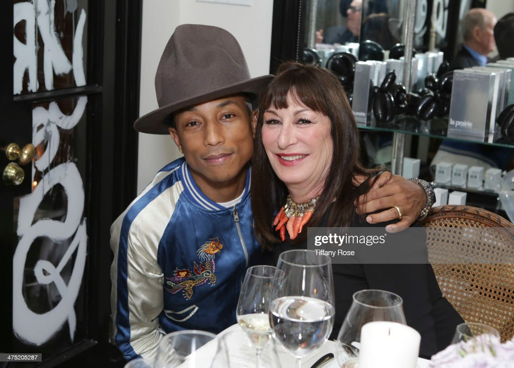 Recording artist <a gi-track='captionPersonalityLinkClicked' href=/galleries/search?phrase=Pharrell+Williams&family=editorial&specificpeople=161396 ng-click='$event.stopPropagation()'>Pharrell Williams</a> and actress <a gi-track='captionPersonalityLinkClicked' href=/galleries/search?phrase=Anjelica+Huston&family=editorial&specificpeople=202921 ng-click='$event.stopPropagation()'>Anjelica Huston</a> attend VIOLET GREY Honors Elizabeth Taylor At She's So Violet Salon Dinner on February 26, 2014 in Los Angeles, California.