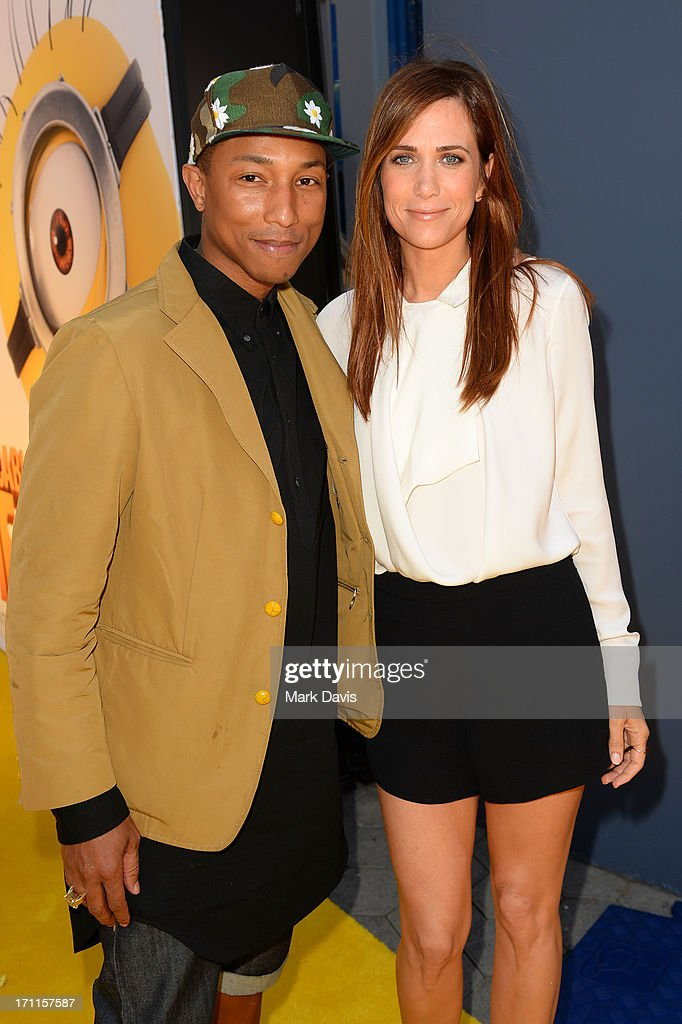 Recording artist Pharrell Williams (L) and actress Kristen Wiig arrive at the premiere of Universal Pictures' 'Despicable Me 2' at Gibson Amphitheatre on June 22, 2013 in Universal City, California.