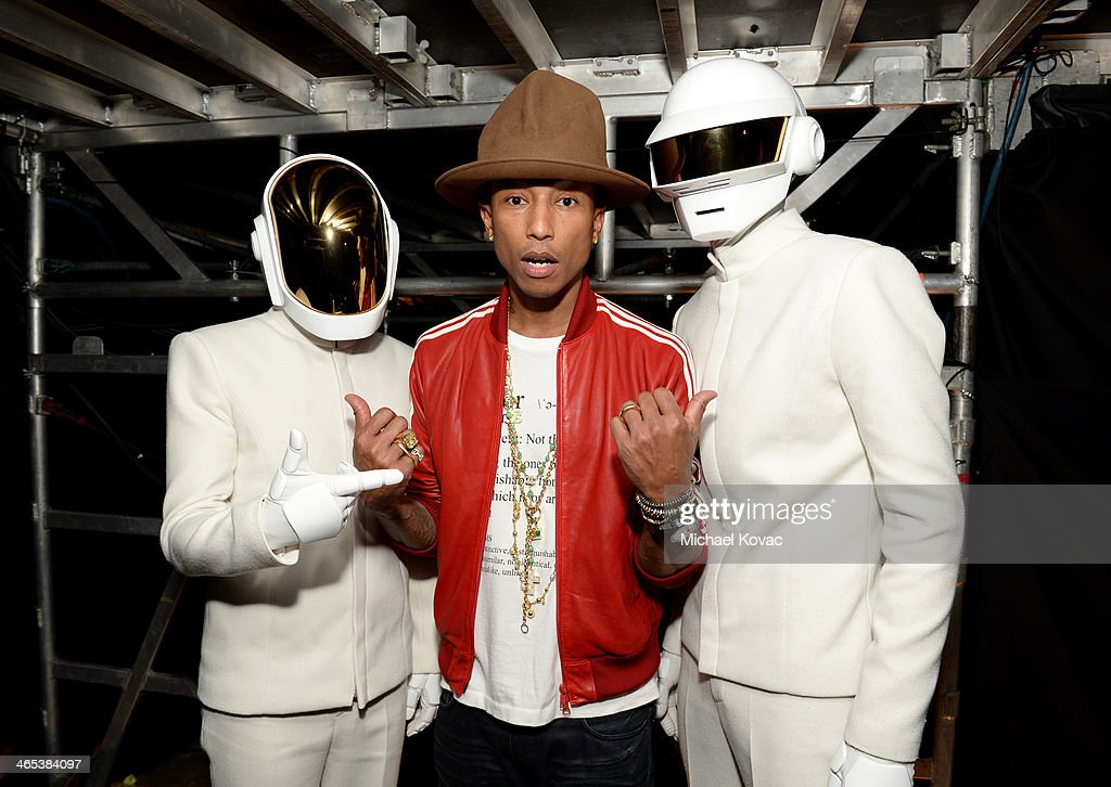 Recording artist <a gi-track='captionPersonalityLinkClicked' href=/galleries/search?phrase=Pharrell+Williams&family=editorial&specificpeople=161396 ng-click='$event.stopPropagation()'>Pharrell Williams</a> (center) and <a gi-track='captionPersonalityLinkClicked' href=/galleries/search?phrase=Daft+Punk&family=editorial&specificpeople=660593 ng-click='$event.stopPropagation()'>Daft Punk</a> attend the 56th GRAMMY Awards at Staples Center on January 26, 2014 in Los Angeles, California.