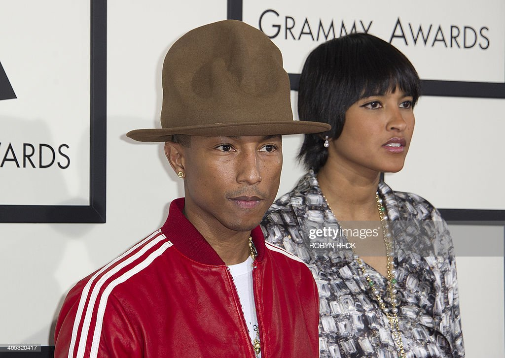 Recording artist Pharrell Williams and Helen Lasichanh arrive on the red carpet for the 56th Grammy Awards at the Staples Center in Los Angeles on...
