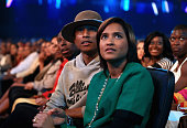 Recording artist Pharrell Williams and Helen Lasichanh attend the BET AWARDS '14 at Nokia Theatre LA LIVE on June 29 2014 in Los Angeles California