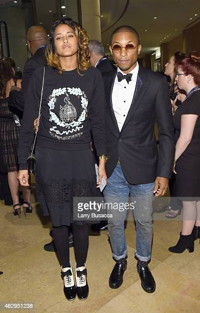 Recording artist Pharrell Williams and Helen Lasichanh attend the PreGRAMMY Gala and Salute To Industry Icons honoring Martin Bandier on February 7...