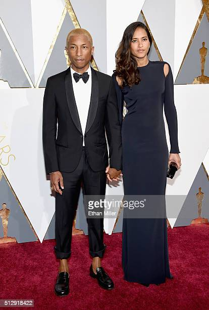 Recording artist Pharrell Williams and Helen Lasichanh attend the 88th Annual Academy Awards at Hollywood Highland Center on February 28 2016 in...