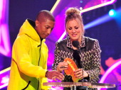 Recording artist Pharrell Williams and Kaley CuocoSweeting getting slimed and presenting an award during Nickelodeon's 27th Annual Kids' Choice...