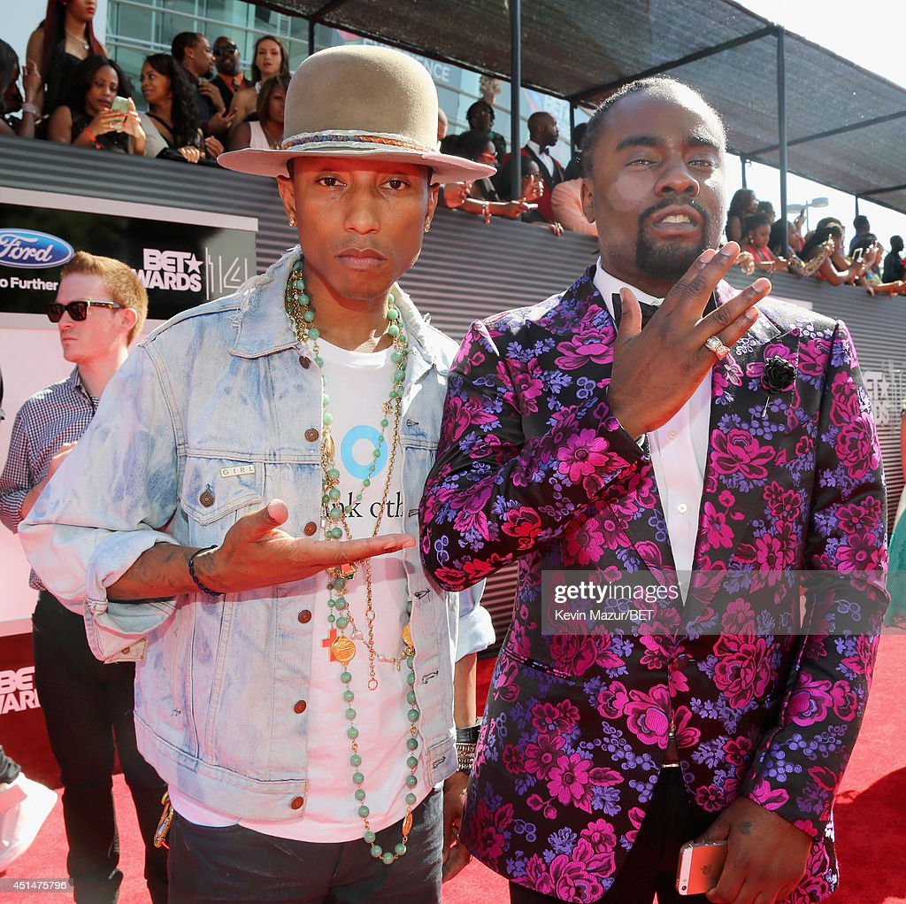 Recording artist Pharrell Williams and rapper Wale attend the BET AWARDS '14 at Nokia Theatre LA LIVE on June 29 2014 in Los Angeles California