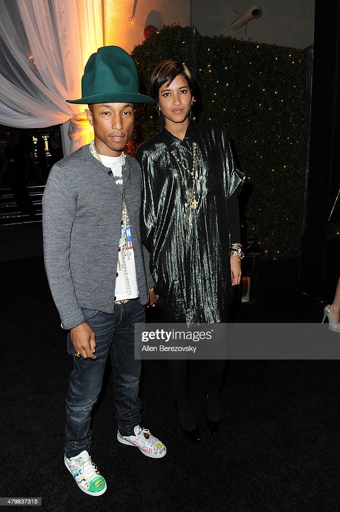 Recording artist Pharrell Williams and wife Helen Lasichanh attend the 2nd Annual Rebel With A Cause Gala cocktail reception at Paramount Studios on March 20, 2014 in Hollywood, California.