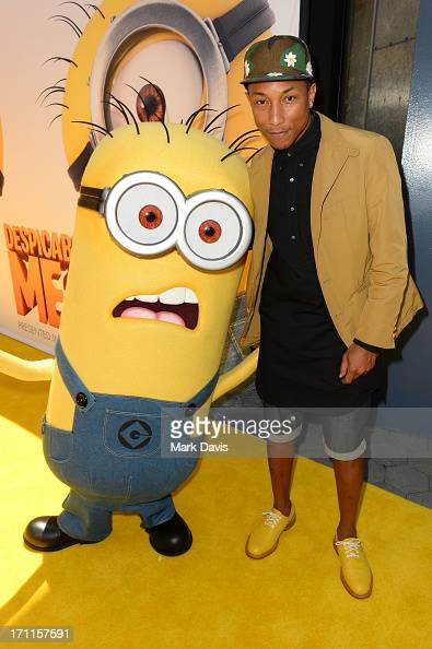 Recording artist Pharrell Williams arrives at the premiere of Universal Pictures' 'Despicable Me 2' at Gibson Amphitheatre on June 22 2013 in...
