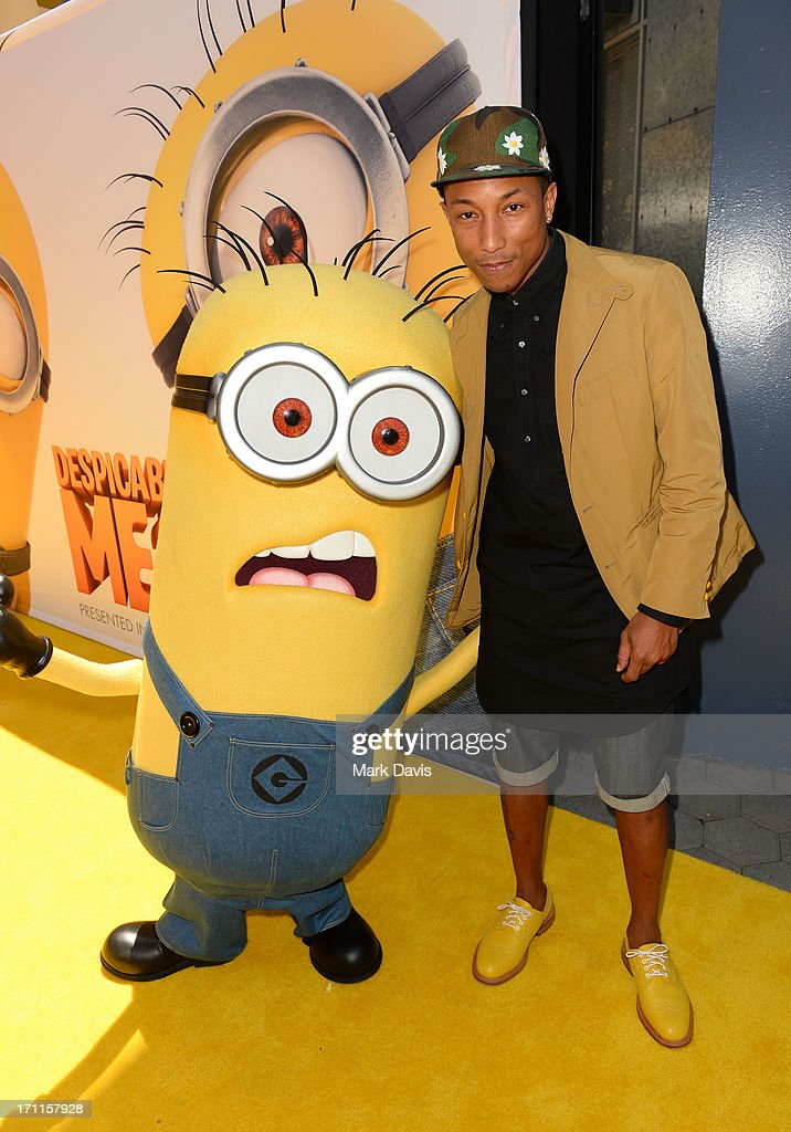 Recording artist <a gi-track='captionPersonalityLinkClicked' href=/galleries/search?phrase=Pharrell+Williams&family=editorial&specificpeople=161396 ng-click='$event.stopPropagation()'>Pharrell Williams</a> (R) arrives at the premiere of Universal Pictures' 'Despicable Me 2' at Gibson Amphitheatre on June 22, 2013 in Universal City, California.