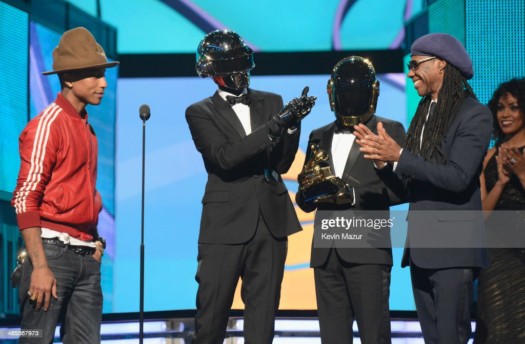 Recording artist <a gi-track='captionPersonalityLinkClicked' href=/galleries/search?phrase=Pharrell+Williams&family=editorial&specificpeople=161396 ng-click='$event.stopPropagation()'>Pharrell Williams</a>, Daft Punk's Thomas Bangalter and <a gi-track='captionPersonalityLinkClicked' href=/galleries/search?phrase=Guy-Manuel+de+Homem-Christo&family=editorial&specificpeople=4018905 ng-click='$event.stopPropagation()'>Guy-Manuel de Homem-Christo</a> and musician <a gi-track='captionPersonalityLinkClicked' href=/galleries/search?phrase=Nile+Rodgers&family=editorial&specificpeople=217582 ng-click='$event.stopPropagation()'>Nile Rodgers</a> accept award onstage during the 56th GRAMMY Awards at Staples Center on January 26, 2014 in Los Angeles, California.