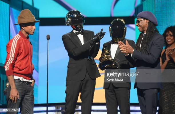 Recording artist Pharrell Williams Daft Punk's Thomas Bangalter and GuyManuel de HomemChristo and musician Nile Rodgers accept award onstage during...
