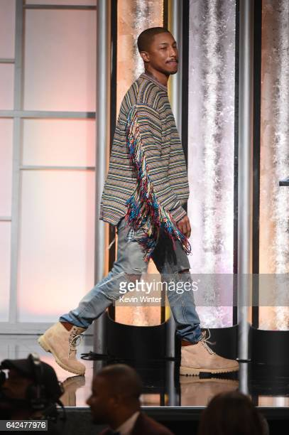 Recording artist Pharrell Williams speaks onstage during BET Presents the American Black Film Festival Honors on February 17 2017 in Beverly Hills...