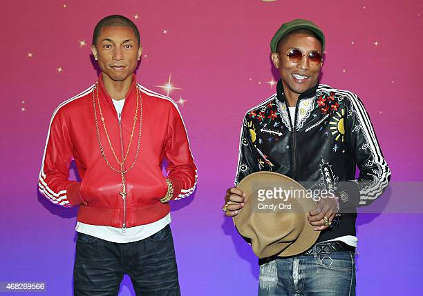 Recording artist Pharrell Williams unveils his neverbeforeseen Madame Tussauds wax figure at Madame Tussauds New York on April 1 2015 in New York City