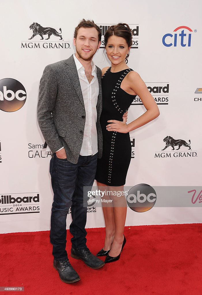 Recording artist <a gi-track='captionPersonalityLinkClicked' href=/galleries/search?phrase=Phillip+Phillips&family=editorial&specificpeople=1651494 ng-click='$event.stopPropagation()'>Phillip Phillips</a> (L) and Hannah Blackwell arrive at the 2014 Billboard Music Awards at the MGM Grand Garden Arena on May 18, 2014 in Las Vegas, Nevada.
