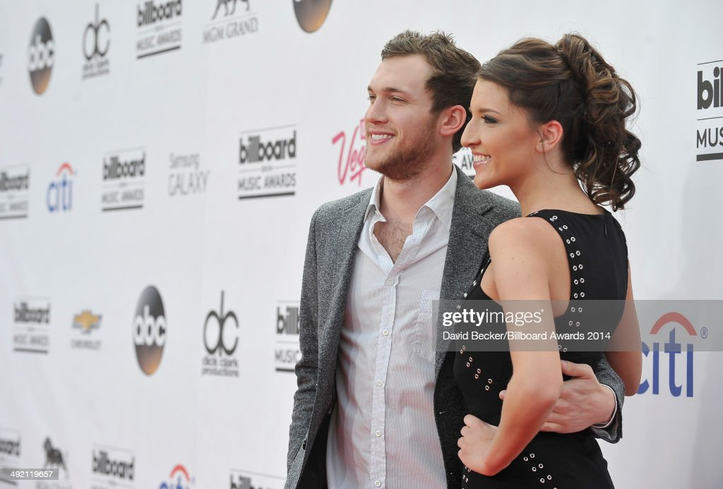 Recording artist <a gi-track='captionPersonalityLinkClicked' href=/galleries/search?phrase=Phillip+Phillips&family=editorial&specificpeople=1651494 ng-click='$event.stopPropagation()'>Phillip Phillips</a> (L) and Hannah Blackwell attend the 2014 Billboard Music Awards at the MGM Grand Garden Arena on May 18, 2014 in Las Vegas, Nevada.