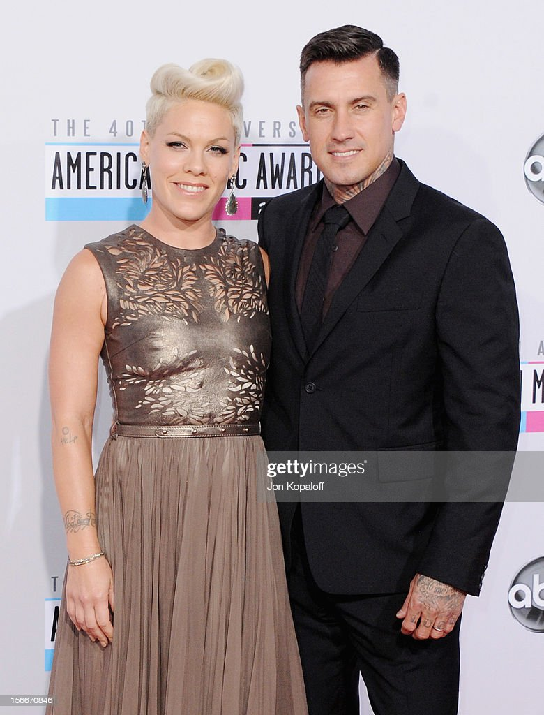 Recording artist Pink and husband Carey Hart arrive at The 40th American Music Awards at Nokia Theatre LA Live on November 18 2012 in Los Angeles...
