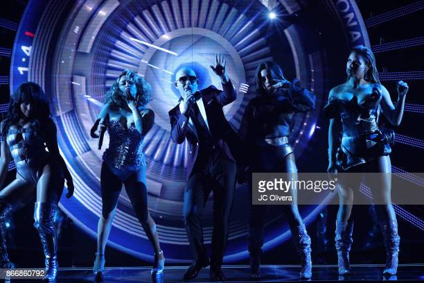 Recording artist Pitbull and Normani Kordei Ally Brooke Lauren Jauregui and Dinah Jane of Fifth Harmony perform onstage during the 2017 Latin...