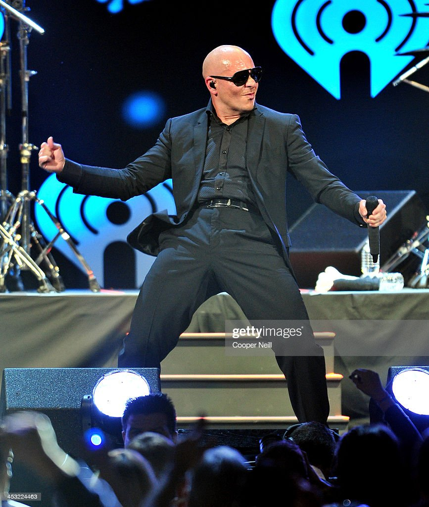 Recording artist Pitbull performs onstage during 106.1 KISS FM's Jingle Ball 2013 at American Airlines Center on December 2, 2013 in Dallas, Texas.