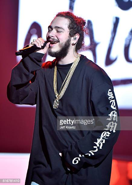 Recording artist Post Malone performs at Justin Bieber's 2016 Purpose World Tour at Staples Center on March 20 2016 in Los Angeles California