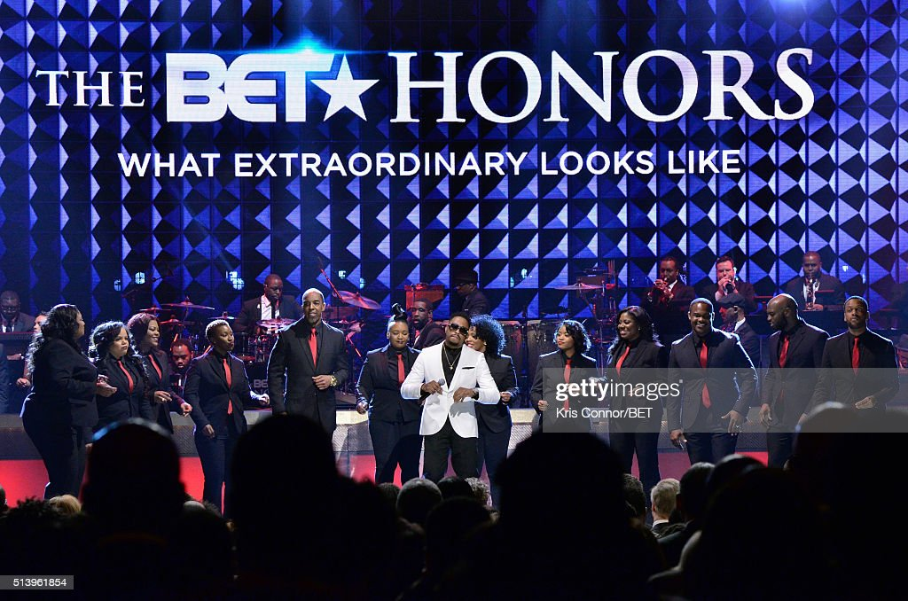 Recording artist Raheem DeVaughn and the Destiny Rode Choir perform on stage during the BET Honors 2016 Show at Warner Theatre on March 5 2016 in...