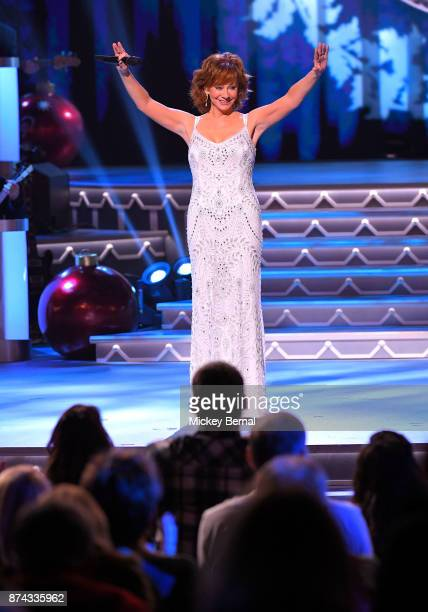 Recording artist Reba McEntire performs during CMA 2017 Country Christmas at The Grand Ole Opry on November 14 2017 in Nashville Tennessee