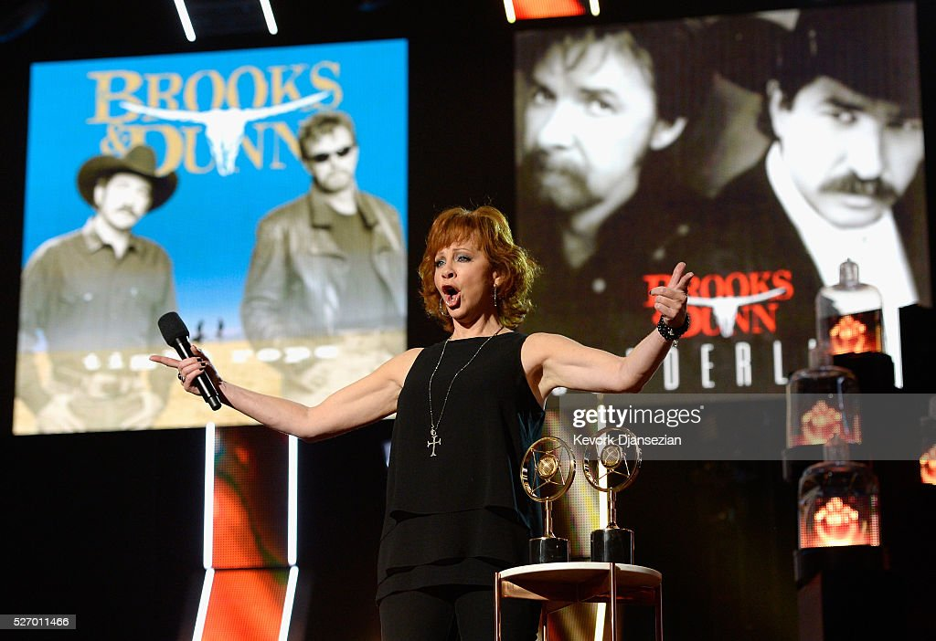 Recording artist <a gi-track='captionPersonalityLinkClicked' href=/galleries/search?phrase=Reba+McEntire&family=editorial&specificpeople=202959 ng-click='$event.stopPropagation()'>Reba McEntire</a> speaks onstage during the 2016 American Country Countdown Awards at The Forum on May 1, 2016 in Inglewood, California.