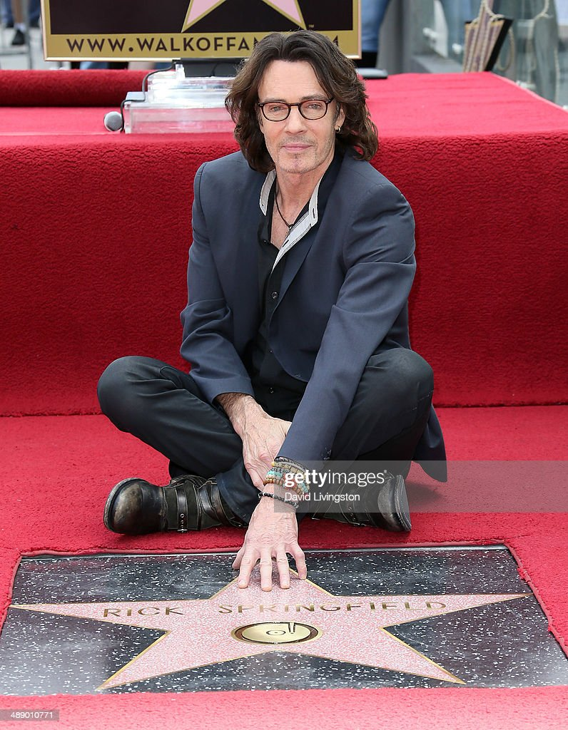 Recording artist <a gi-track='captionPersonalityLinkClicked' href=/galleries/search?phrase=Rick+Springfield&family=editorial&specificpeople=242775 ng-click='$event.stopPropagation()'>Rick Springfield</a> is honored with a Star on the Hollywood Walk of Fame on May 9, 2014 in Hollywood, California.