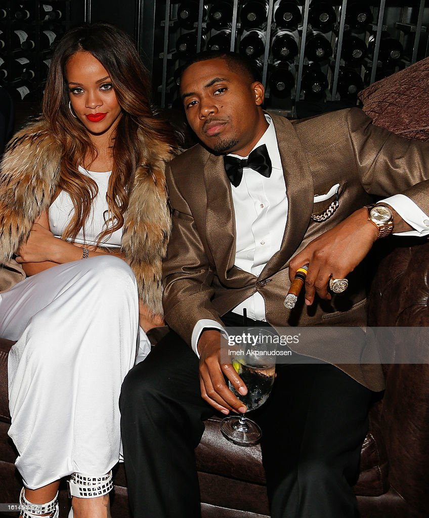 Recording artist Rihanna (L) and rapper Nas attend the Island Def Jam Grammy Party sponsored by Samsung and Pepsi at Osteria Mozza on February 10, 2013 in Los Angeles, California.