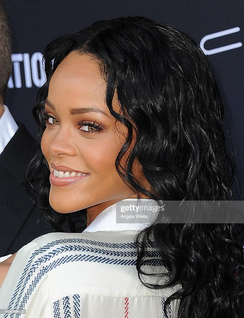 Recording artist <a gi-track='captionPersonalityLinkClicked' href=/galleries/search?phrase=Rihanna&family=editorial&specificpeople=453439 ng-click='$event.stopPropagation()'>Rihanna</a> arrives at the Roc Nation Pre-Grammy brunch presented by MAC Viva Glam at a private residency on January 25, 2014 in Los Angeles, California.
