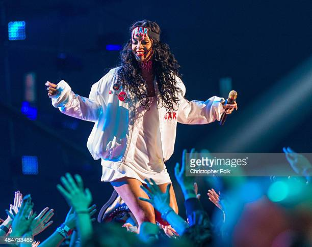 Recording artist Rihanna performs onstage at the 2014 MTV Movie Awards at Nokia Theatre LA Live on April 13 2014 in Los Angeles California