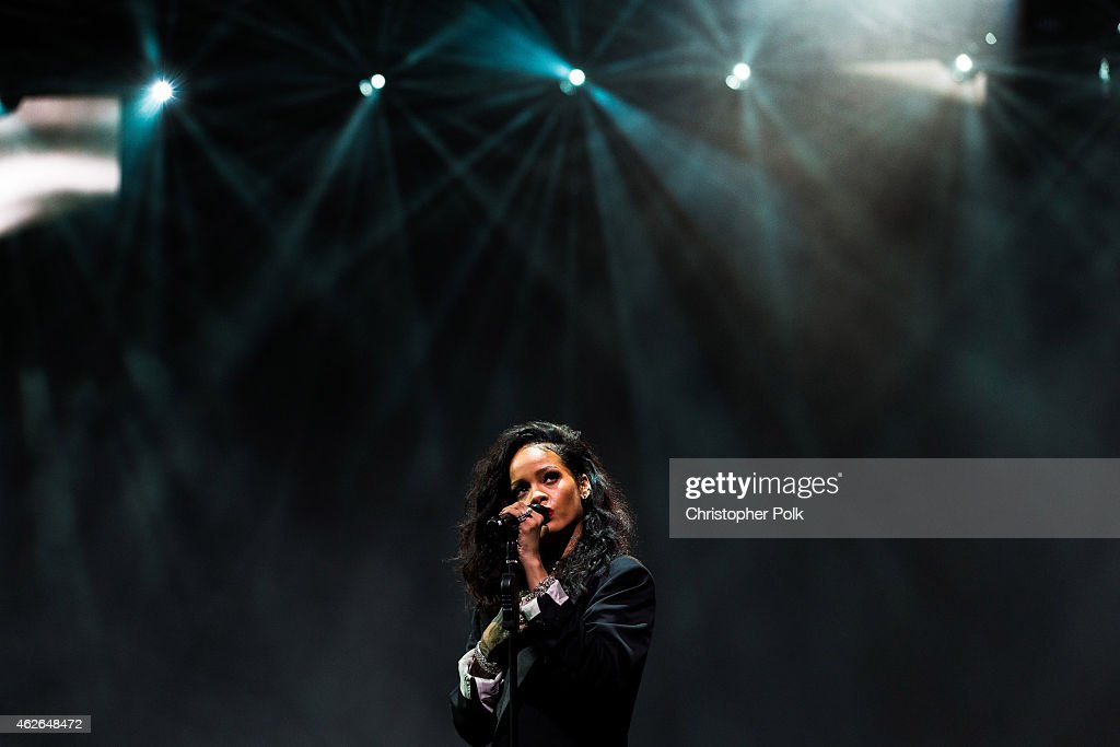 Recording artist Rihanna performs onstage during DirecTV Super Saturday Night hosted by Mark Cuban's AXS TV and Pro Football Hall of Famer Michael...