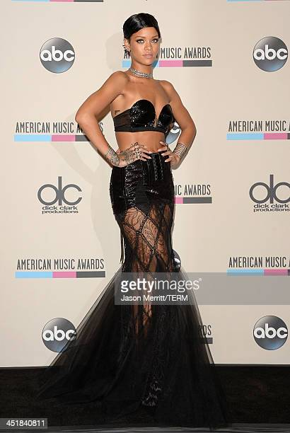 Recording artist Rihanna poses in the press room during the 2013 American Music Awards at Nokia Theatre LA Live on November 24 2013 in Los Angeles...