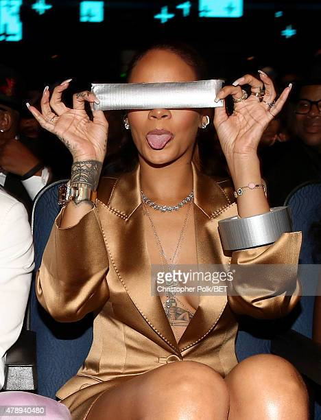 Recording artist Rihanna poses with a piece of duct tape at the 2015 BET Awards at the Microsoft Theater on June 28 2015 in Los Angeles California