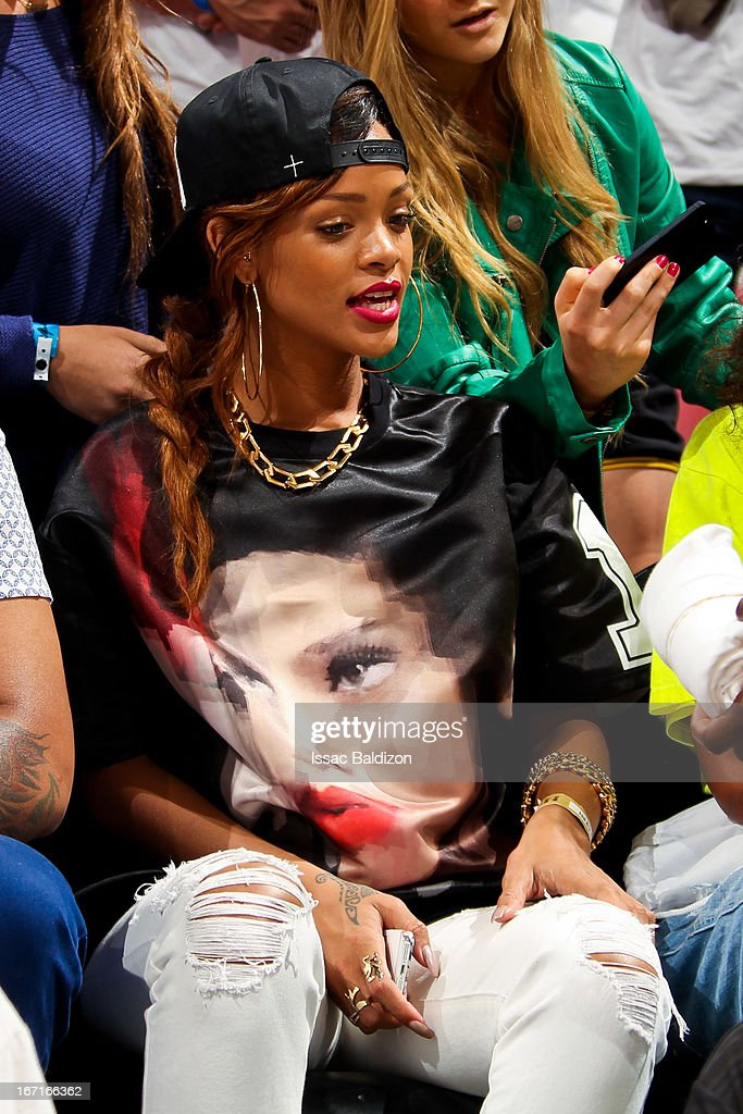 Recording artist Rihanna sits court-side as the Milwaukee Bucks play the Miami Heat in Game One of the Eastern Conference Quarterfinals during the 2013 NBA Playoffs on April 21, 2013 at American Airlines Arena in Miami, Florida.