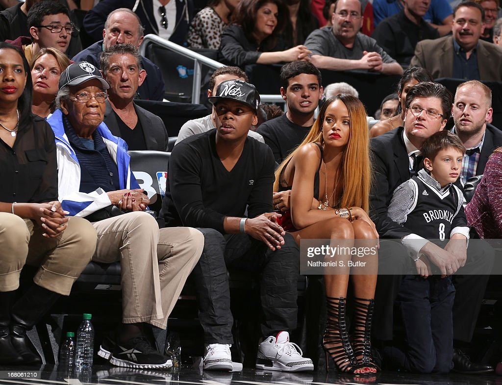 Recording artist Rihanna sits court-side during the Game Seven of the Eastern Conference Quarterfinals between the Chicago Bulls and the Brooklyn Nets during the 2013 NBA Playoffs at the Barclays Center on May 4, 2013 in the Brooklyn borough of New York City.