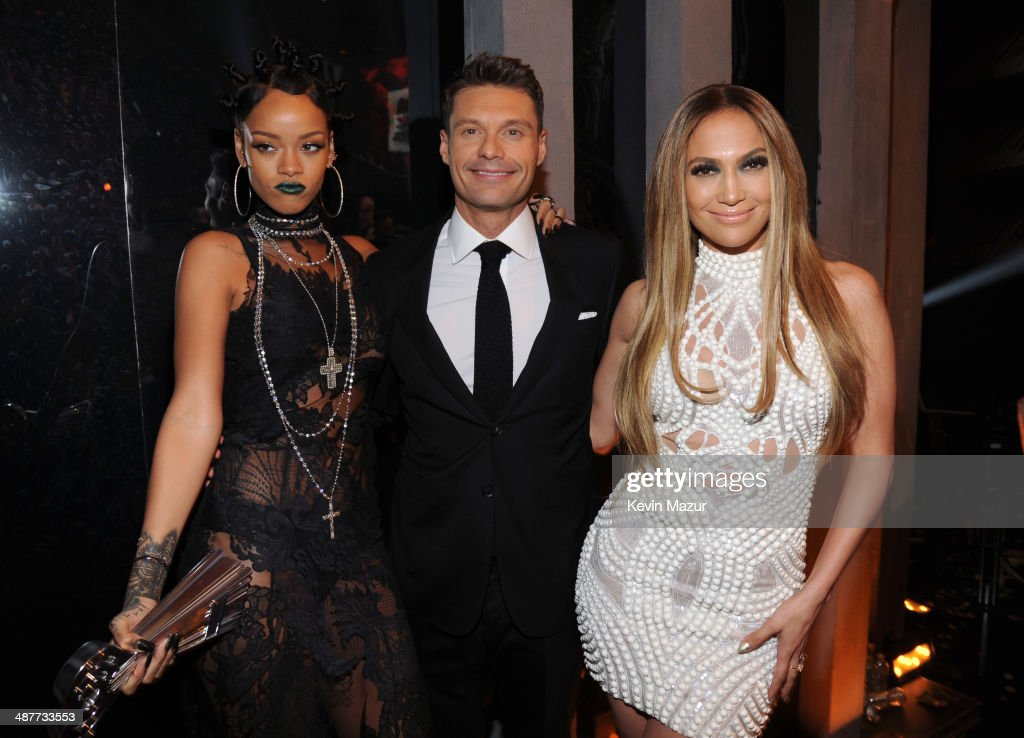 Recording artist Rihanna, TV personality Ryan Seacrest and actress/recording artist Jennifer Lopez backstage at the 2014 iHeartRadio Music Awards held at The Shrine Auditorium on May 1, 2014 in Los Angeles, California. iHeartRadio Music Awards are being broadcast live on NBC.