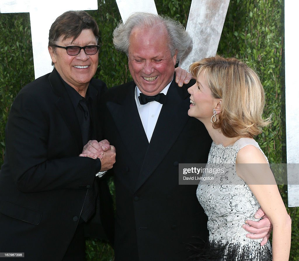 Recording artist Robbie Robertson, Vanity Fair Editor-in-Chief Graydon Carter and wife Anna Scott attend the 2013 Vanity Fair Oscar Party at the Sunset Tower Hotel on February 24, 2013 in West Hollywood, California.