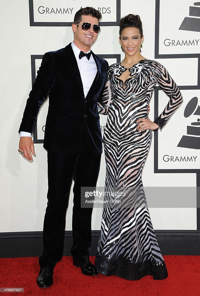 Recording Artist Robin Thicke (L) and actress Paula Patton arrive at the 56th GRAMMY Awards at Staples Center on January 26, 2014 in Los Angeles, California.