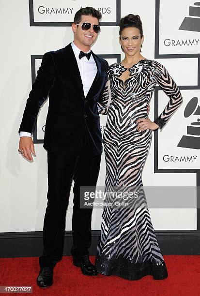 Recording Artist Robin Thicke and actress Paula Patton arrive at the 56th GRAMMY Awards at Staples Center on January 26 2014 in Los Angeles California