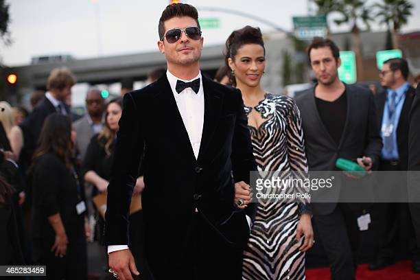 Recording artist Robin Thicke and actress Paula Patton attend the 56th GRAMMY Awards at Staples Center on January 26 2014 in Los Angeles California