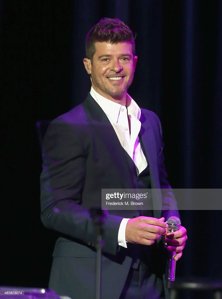 Recording artist <a gi-track='captionPersonalityLinkClicked' href=/galleries/search?phrase=Robin+Thicke&family=editorial&specificpeople=724390 ng-click='$event.stopPropagation()'>Robin Thicke</a> performs onstage during the GRAMMY Foundation's 17th annual Legacy Concert Lean On Me: A Celebration of Music and Philanthropy at Wilshire Ebell Theatre on February 5, 2015 in Los Angeles, California. For more information visit grammyfoundation.org.