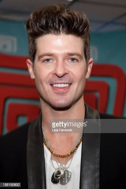 Recording artist Robin Thicke promotes his new album 'Love After War' at JR Music World on December 6 2011 in New York City