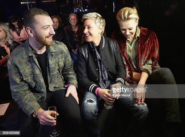 Recording artist Sam Smith tv personality Ellen DeGeneres and actress Portia de Rossi in Saint Laurent by Hedi Slimane attend Saint Laurent at the...