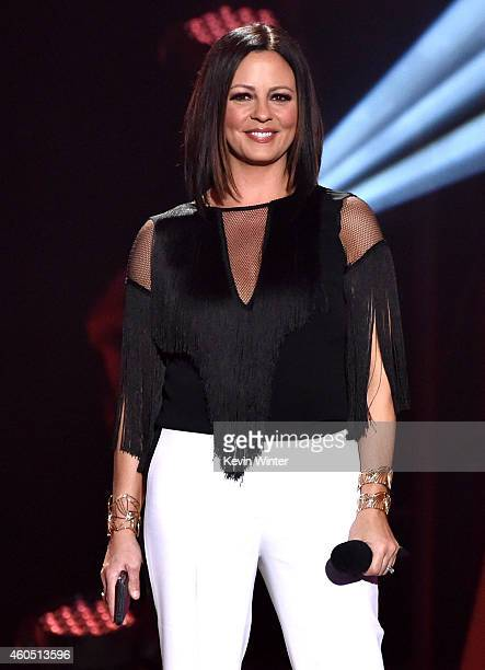 Recording artist Sara Evans speaks onstage during the 2014 American Country Countdown Awards at Music City Center on December 15 2014 in Nashville...