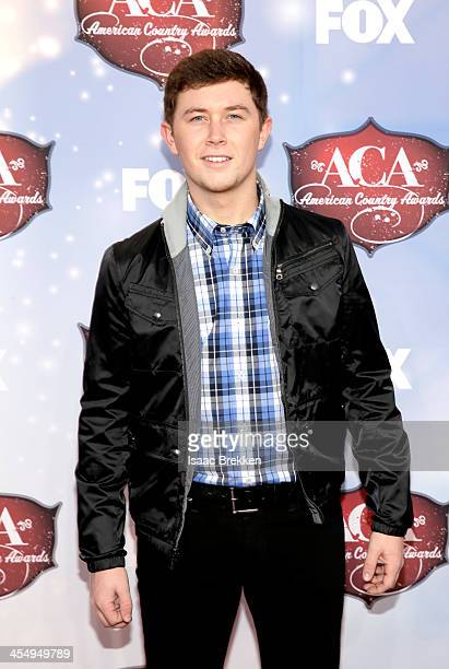 Recording artist Scotty McCreery arrives at the American Country Awards 2013 at the Mandalay Bay Events Center on December 10 2013 in Las Vegas Nevada
