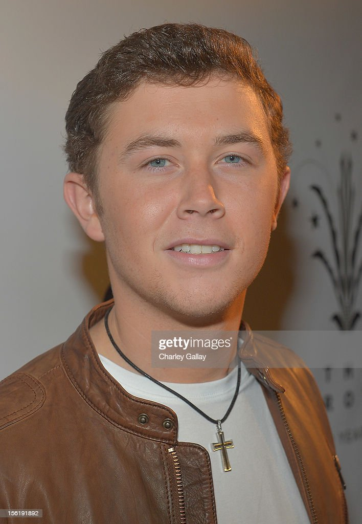 Recording artist <a gi-track='captionPersonalityLinkClicked' href=/galleries/search?phrase=Scotty+McCreery&family=editorial&specificpeople=7520936 ng-click='$event.stopPropagation()'>Scotty McCreery</a> attends The Grove's 10th Annual Star Studded Holiday Tree Lighting Spectacular Presented By Citi at The Grove on November 11, 2012 in Los Angeles, California.